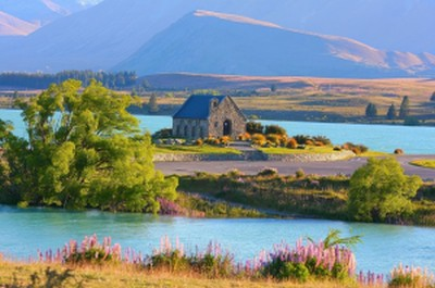 New Zealand South Island Attractions Gorgeous coloured water and alps behind the Church of the Good Shepherd